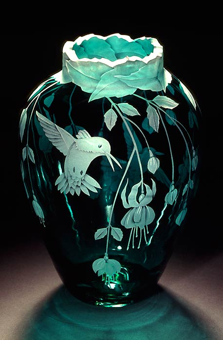 Fuchsias and  Hummingbirds  the shape of this vase has changed a bit the lip is more flared art glass by Cynthia Myers
